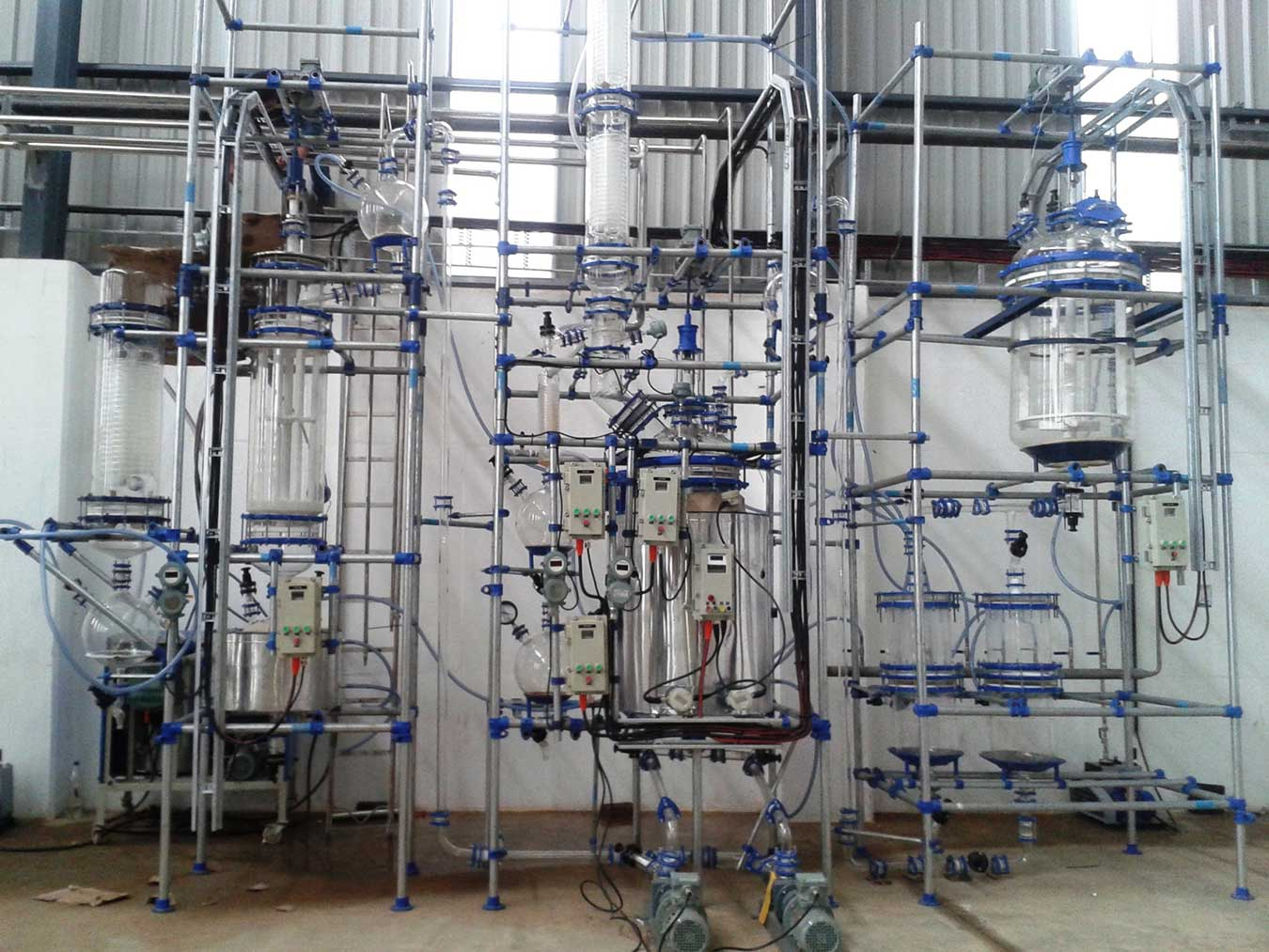Glass Pilot plant containing Solid Liquid Extraction-Filtration-Wiped Film Evaporator